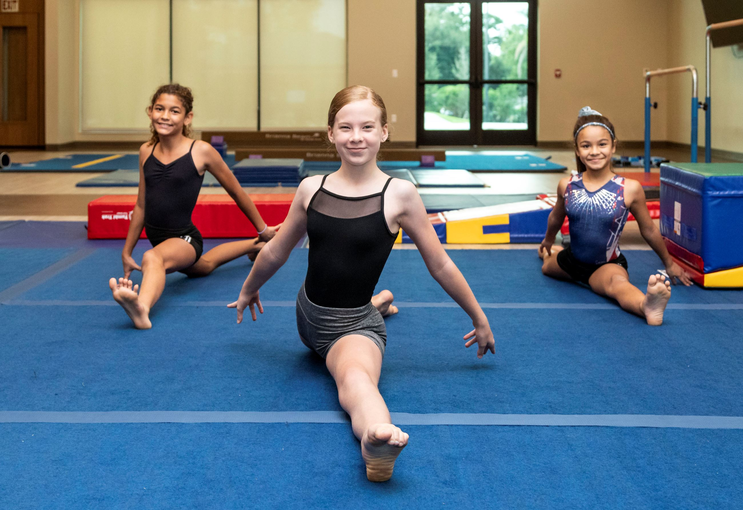 Girls Doing Splits In Gymnastics Class